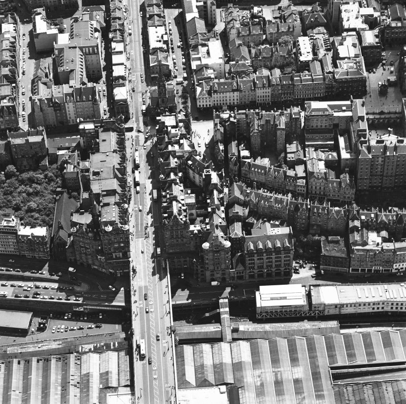 Oblique aerial view centred on the Scotsman buildings, taken from the N.