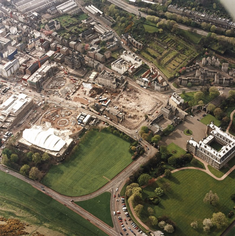 Oblique aerial view of Edinburgh centred on the construction of the Scottish Parliament with the 'Our Dynamic Earth' building adjacent, taken from the SE.