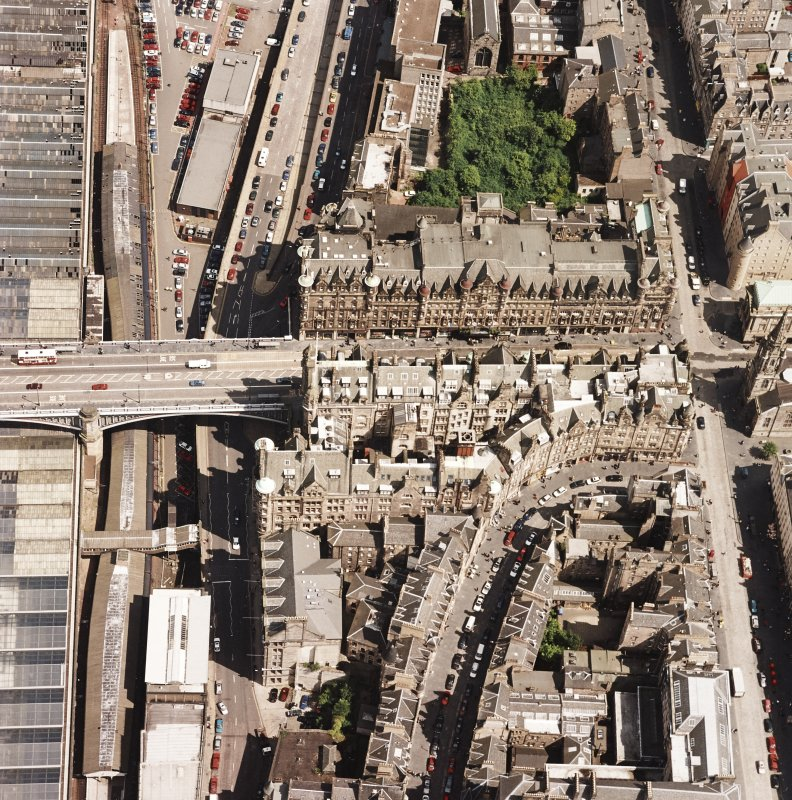 Oblique aerial view centred on the Scotsman buildings, taken from the W.