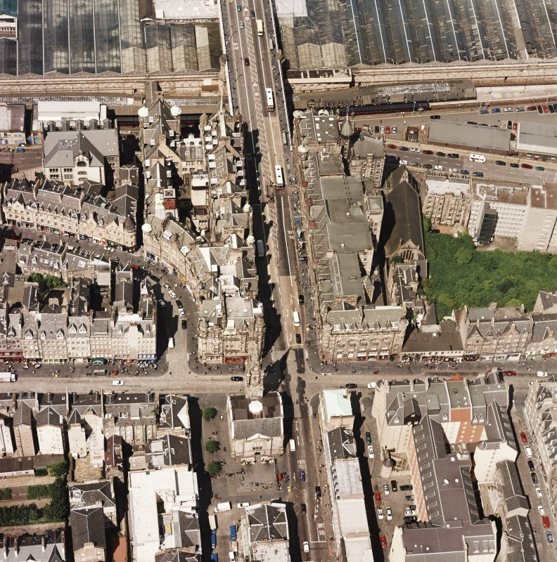 Oblique aerial view centred on the Scotsman buildings, taken from the S.