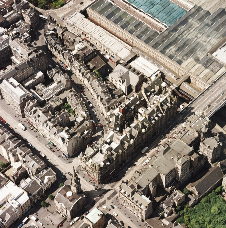 Oblique aerial view centred on the Scotsman buildings, taken from the SE.
