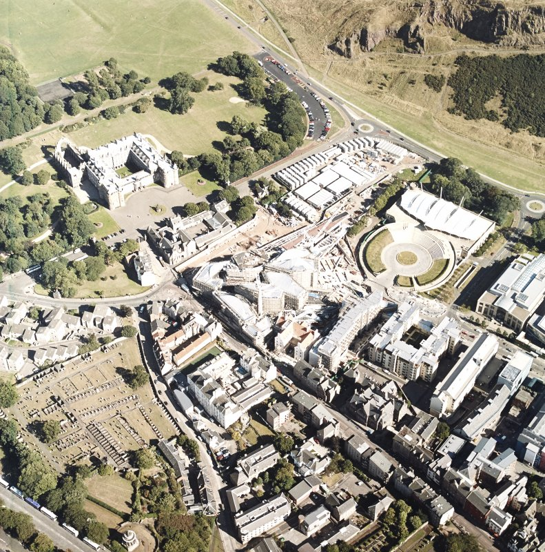 Oblique aerial view centred on the construction of the Scottish Parliament with the exhibition centre and palace adjacent, taken from the WNW.