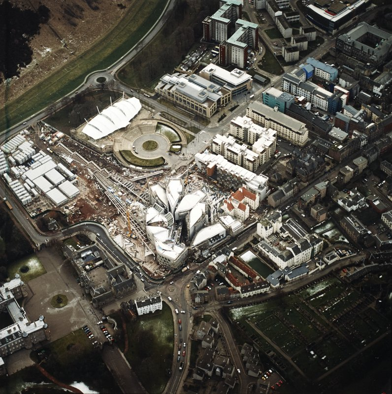 Oblique aerial view centred on the construction of the Scottish Parliament with `Our Dynamic Earth¿ adjacent, taken from the NNE.