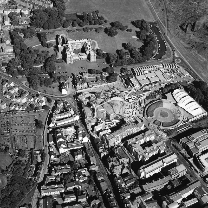 Oblique aerial view centred on the construction of the Scottish Parliament with the exhibition centre and palace adjacent, taken from the W.