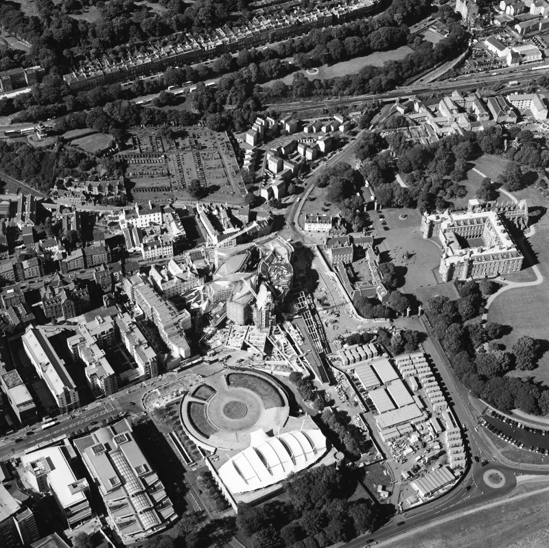 Oblique aerial view centred on the construction of the Scottish Parliament with the exhibition centre and palace adjacent, taken from the S.