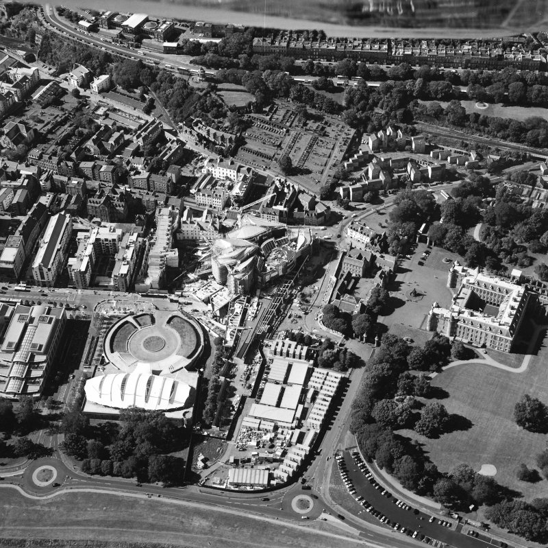 Oblique aerial view centred on the construction of the Scottish Parliament with the exhibition centre and palace adjacent, taken from the SE.