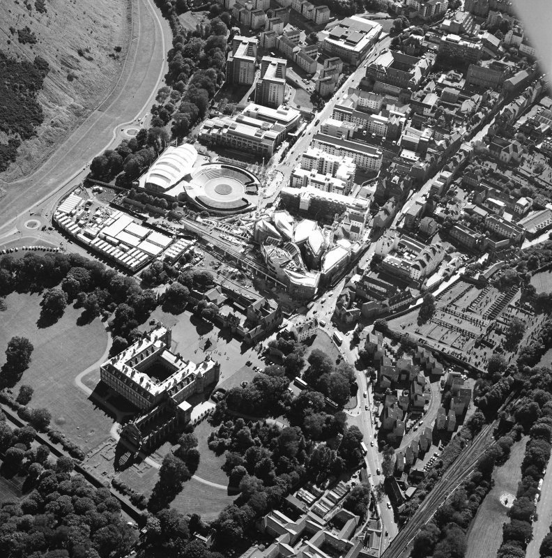Oblique aerial view centred on the construction of the Scottish Parliament with the exhibition centre and palace adjacent, taken from the NNE.