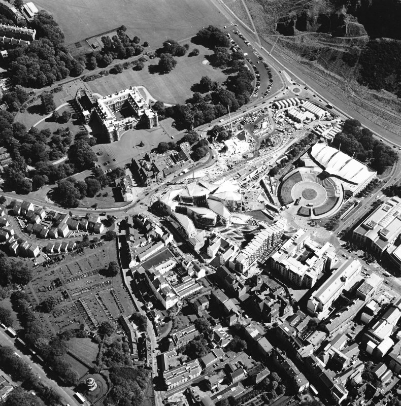 Oblique aerial view centred on the Scottish parliament building with `Our Dynamic Earth¿ and Holyrood palace adjacent, taken from the NW.