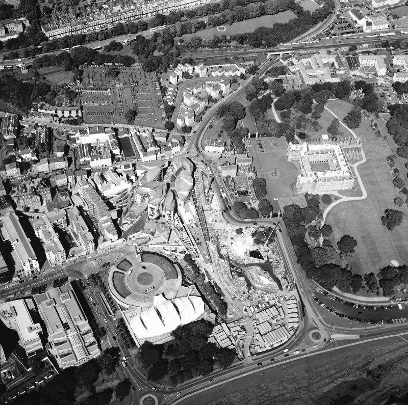 Oblique aerial view centred on the Scottish parliament building with `Our Dynamic Earth¿ and Holyrood palace adjacent, taken from the S.