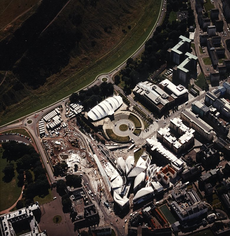 Oblique aerial view centred on the Scottish parliament building with `Our Dynamic Earth¿ and Holyrood palace adjacent, taken from the N.