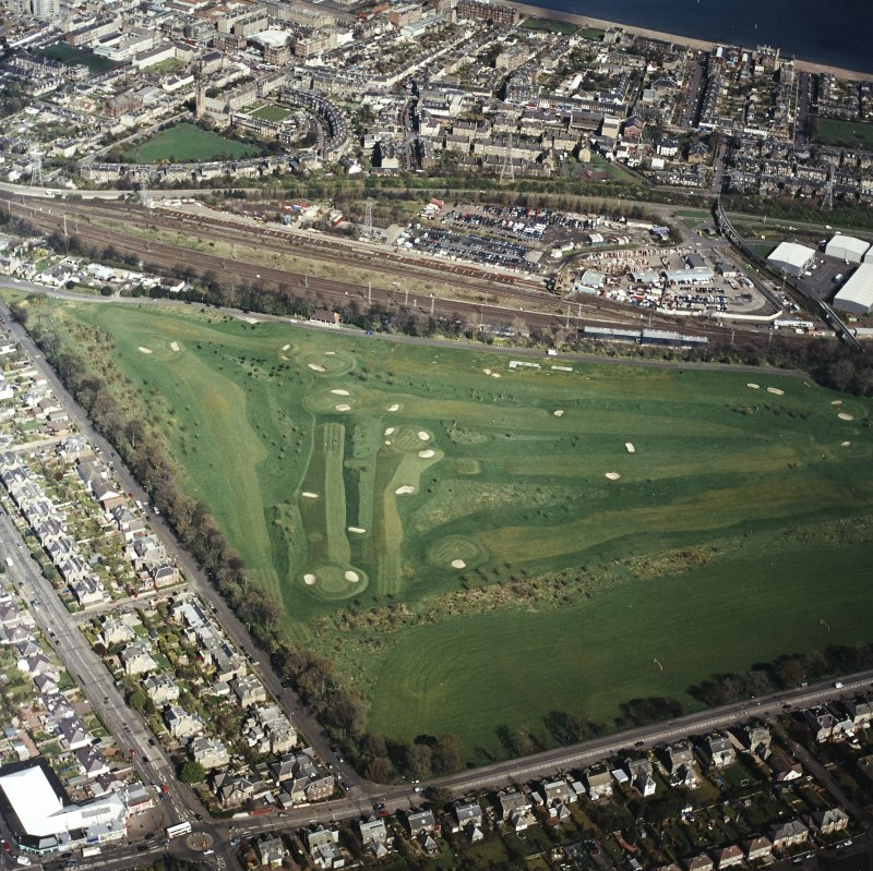 Oblique aerial view centred on the railway sidings, with Portobello and a golf course adjacent, taken from the SSW.