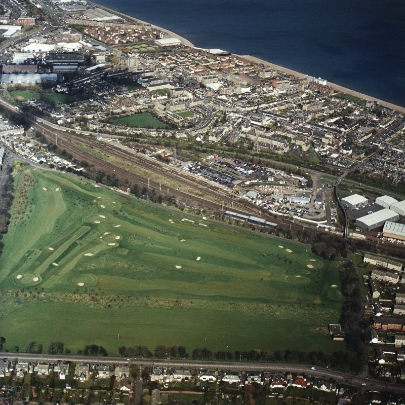 Oblique aerial view centred on the railway sidings, with Portobello and a golf course adjacent, taken from the SSE.