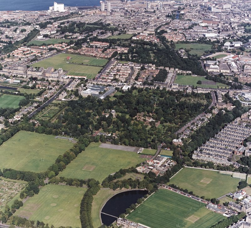 Edinburgh, oblique aerial view, taken from the SSW, centred on the Royal Botanic Gardens and Inverleith House, with the Stockbridge Colonies and the Tanfield headquarters of Standard Life Assurance in the centre right. Powderhall stadium is visible in the top right-hand corner.