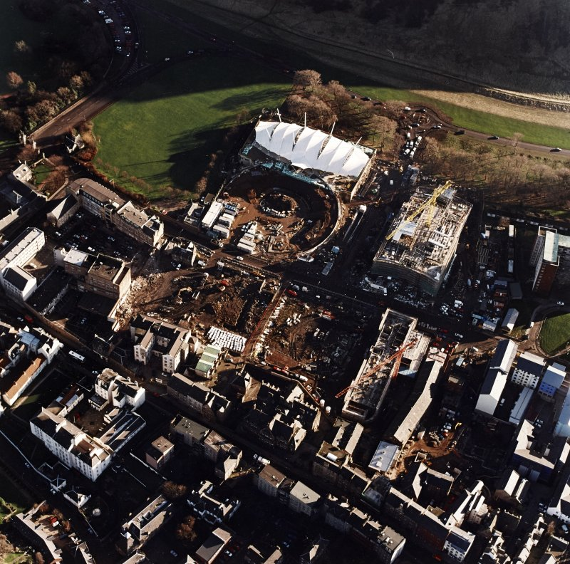 Oblique aerial view centred on the Scottish parliament and `Our Dynamic Earth' under construction, taken from the NW.