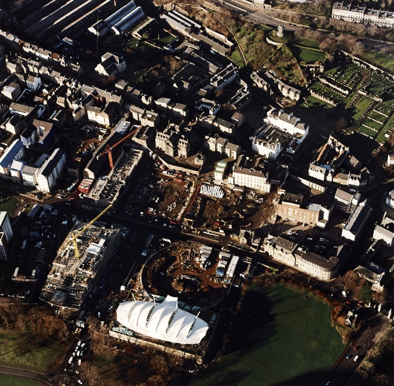 Oblique aerial view of Edinburgh centred on the construction of the Scottish Parliament with the construction of 'Our Dynamic Earth' adjacent, taken from the SE.