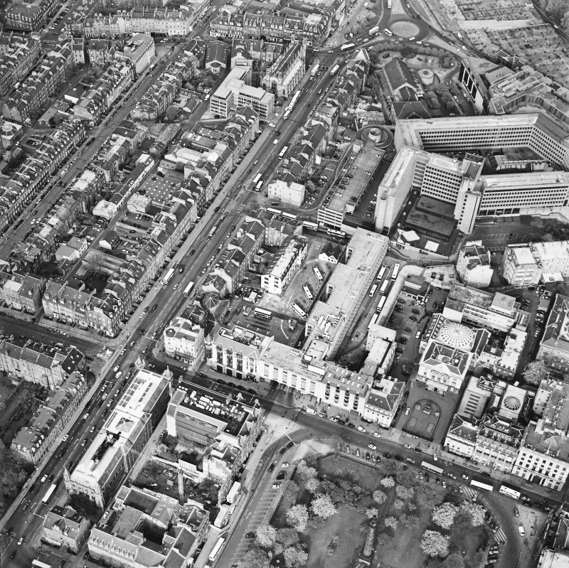 Oblique aerial view of Edinburgh centred on the St Andrew's Square Bus Station before demolition, taken from the SW.