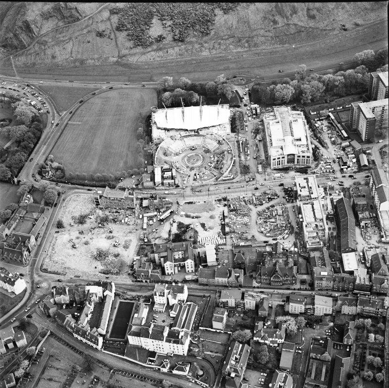 Oblique aerial view of Edinburgh centred on the construction of the Scottish Parliament with the 'Our Dynamic Earth' building adjacent, taken from the NNW.