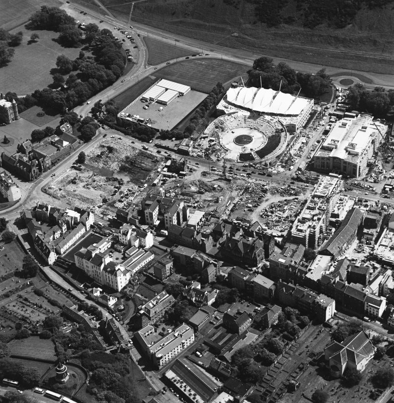 Oblique aerial view centred on the construction site, with exhibition centre and Queensbury House adjacent, taken from the N.