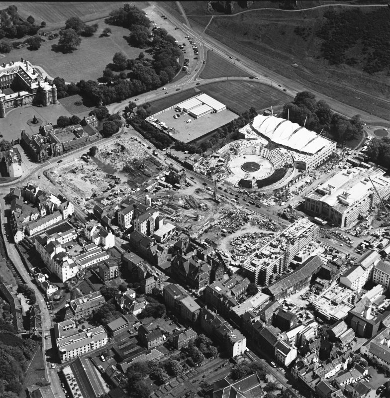 Oblique aerial view centred on the construction site, with exhibition centre and Queensbury House adjacent, taken from the NW.