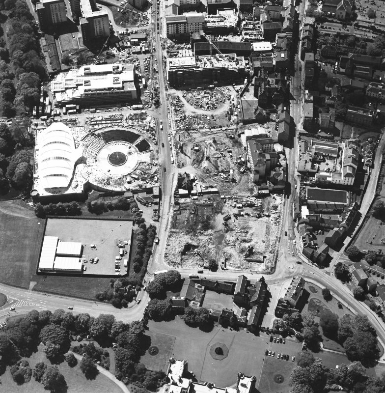 Oblique aerial view centred on the construction site, with exhibition centre and Queensbury House adjacent, taken from the E.