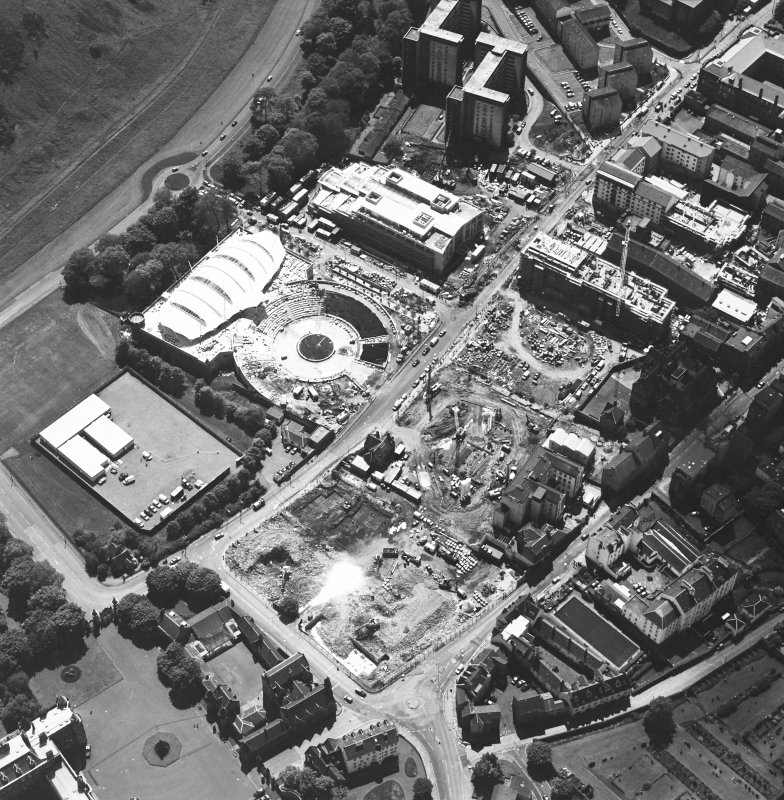 Oblique aerial view centred on the construction site, with exhibition centre and Queensbury House adjacent, taken from the NE.