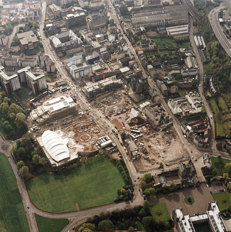 Oblique aerial view of Edinburgh centred on the construction of the Scottish Parliament with the 'Our Dynamic Earth' building adjacent, taken from the E.