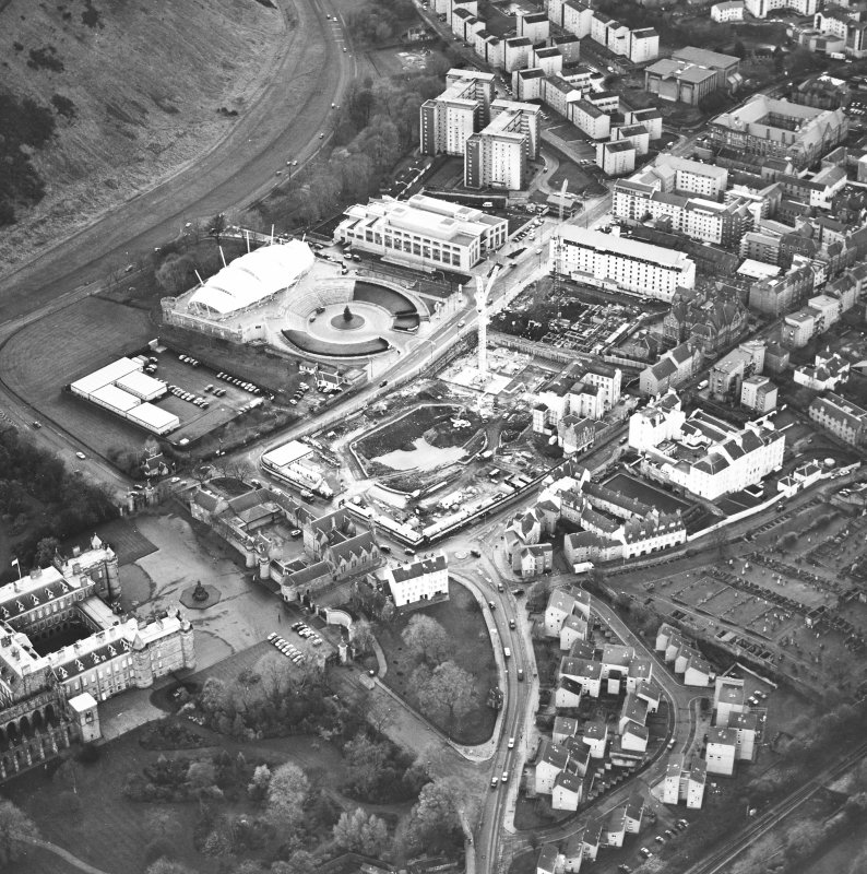 Oblique aerial view centred on the Scottish parliament under construction with `Our Dynamic Earth¿ and palace adjacent, taken from the NNE.
