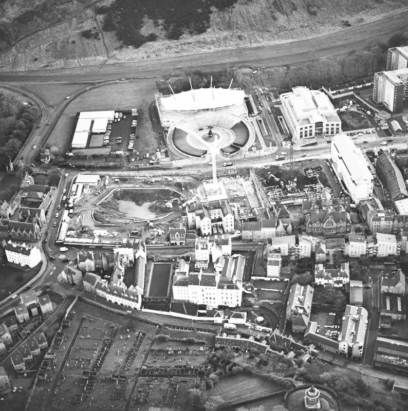 Oblique aerial view centred on the Scottish parliament under construction with `Our Dynamic Earth¿ adjacent, taken from the NW.
