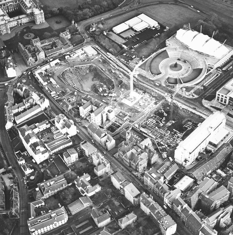 Oblique aerial view centred on the Scottish parliament under construction with `Our Dynamic Earth¿ adjacent, taken from the WNW.