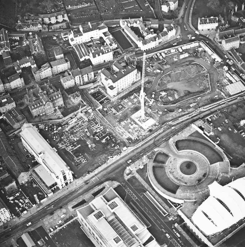 Oblique aerial view centred on the Scottish parliament under construction with `Our Dynamic Earth¿ adjacent, taken from the S.