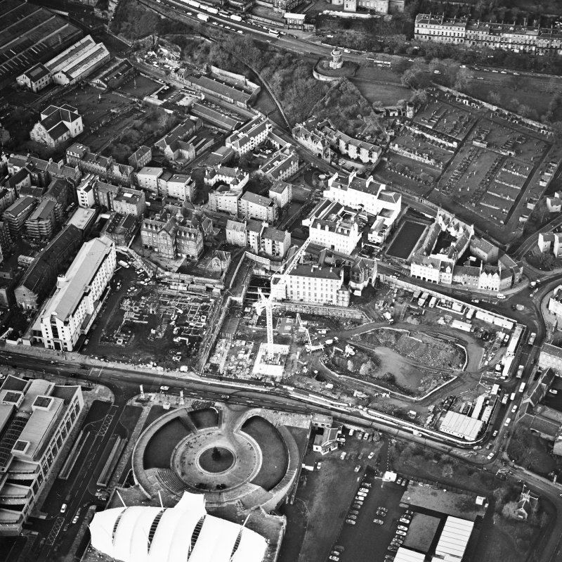 Oblique aerial view centred on the Scottish parliament under construction with `Our Dynamic Earth¿ adjacent, taken from the SE.