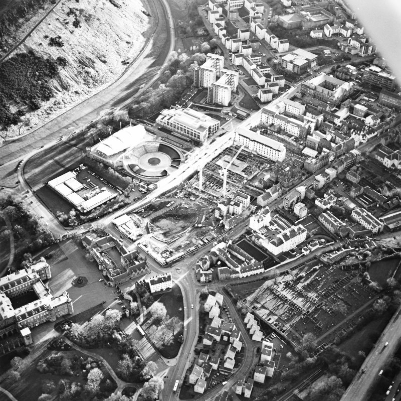 Oblique aerial view centred on the Scottish parliament under construction with `Our Dynamic Earth' adjacent, taken from the N.