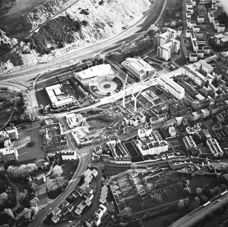 Oblique aerial view centred on the Scottish parliament under construction with `Our Dynamic Earth¿ adjacent, taken from the NNW.