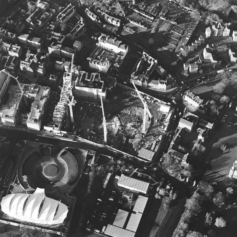 Oblique aerial view centred on the Scottish parliament under construction with `Our Dynamic Earth' adjacent, taken from the SE.