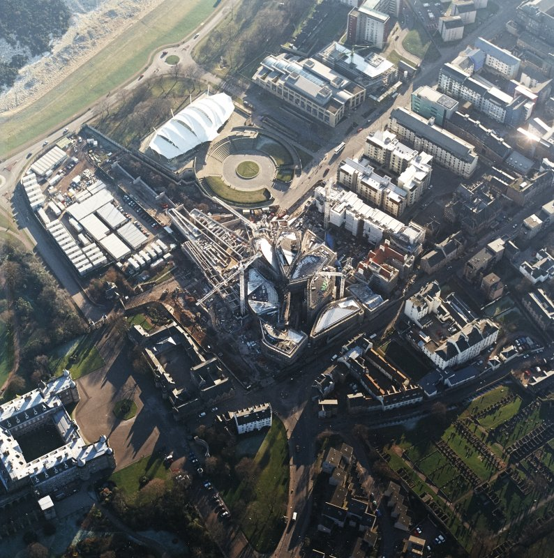 Oblique aerial view centred on the construction of the Scottish parliament, taken from the NNE.