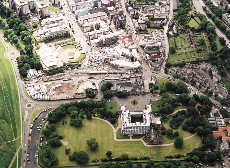 Oblique aerial view centred on the construction of the Scottish Parliament with the exhibition centre and palace adjacent, taken from the E.