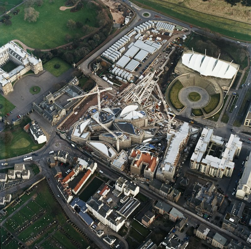 Oblique aerial view centred on the construction of the Scottish Parliament with exhibition centre adjacent, taken from the WNW.