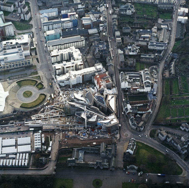 Oblique aerial view centred on the construction of the Scottish Parliament, taken from the ENE.