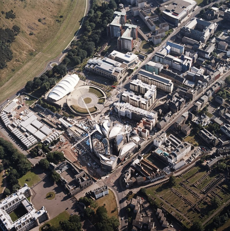 Oblique aerial view centred on the construction of the Scottish Parliament with the exhibition centre adjacent, taken from the NNE.