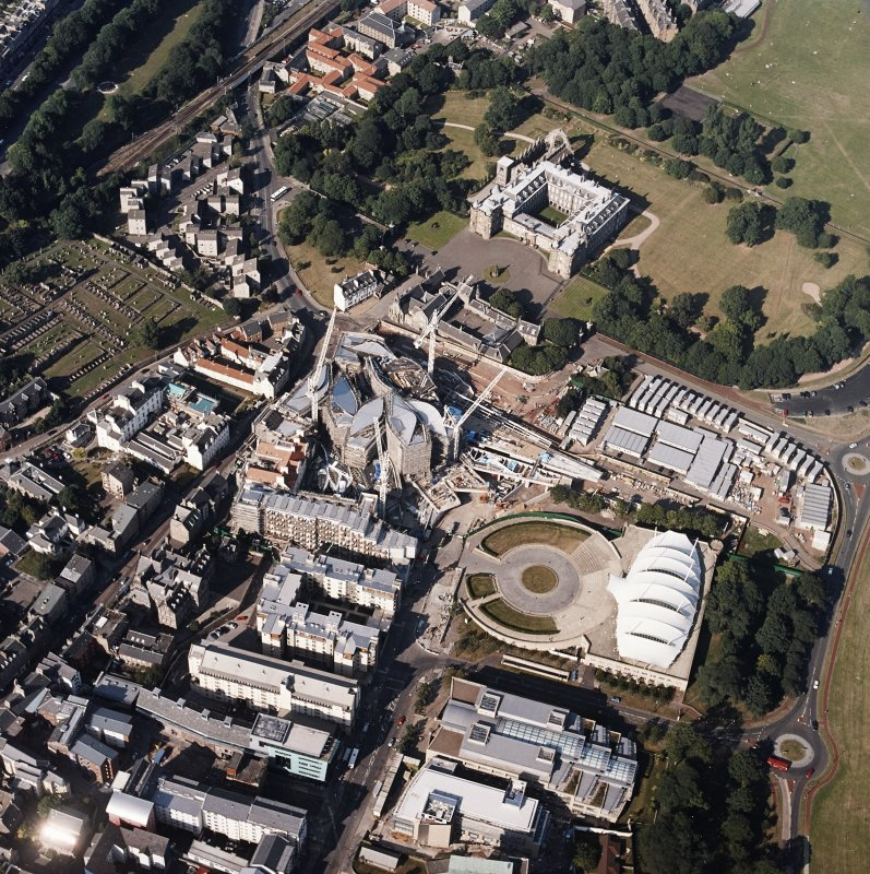 Oblique aerial view centred on the construction of the Scottish Parliament with the exhibition centre and palace adjacent, taken from the SW.