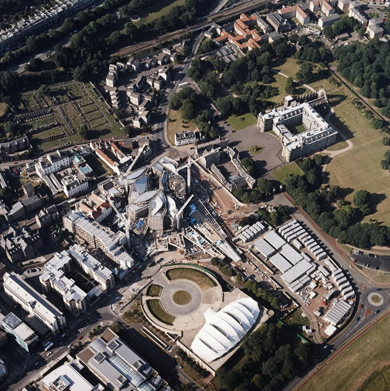 Oblique aerial view centred on the construction of the Scottish Parliament with the exhibition centre and palace adjacent, taken from the SSW.