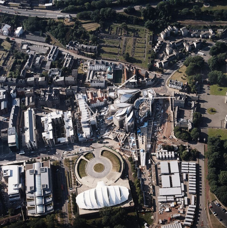 Oblique aerial view centred on the construction of the Scottish Parliament with the exhibition centre adjacent, taken from the SSE.