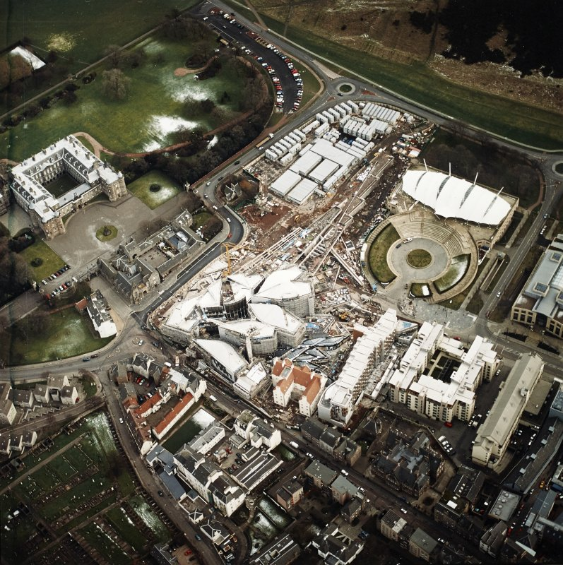 Oblique aerial view centred on the construction of the Scottish Parliament with `Our Dynamic Earth¿ and Holyrood Palace adjacent, taken from the NW.