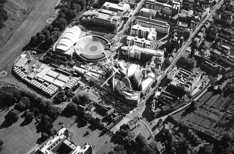Oblique aerial view centred on the construction of the Scottish Parliament with the exhibition centre adjacent, taken from the NE.