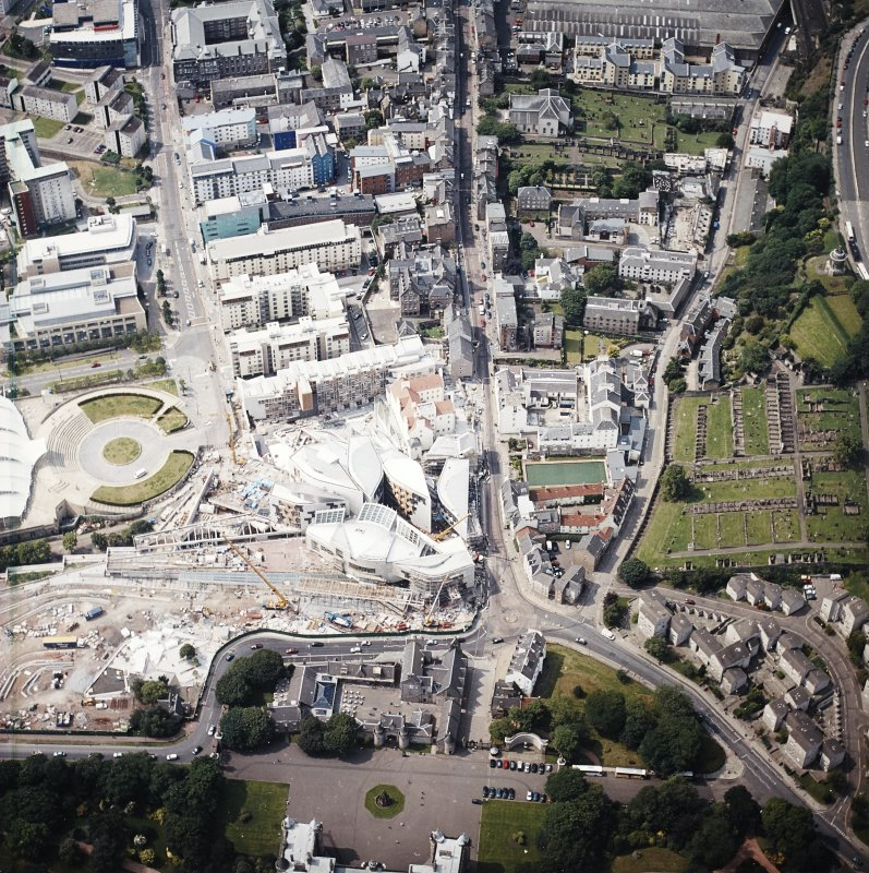Oblique aerial view centred on the Scottish Parliament under construction, taken from the ENE.