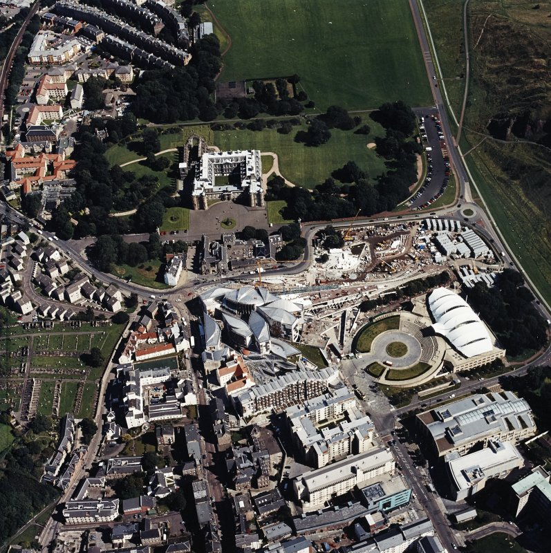 Oblique aerial view centred on the Scottish parliament building with `Our Dynamic Earth¿ and Holyrood palace adjacent, taken from the W.