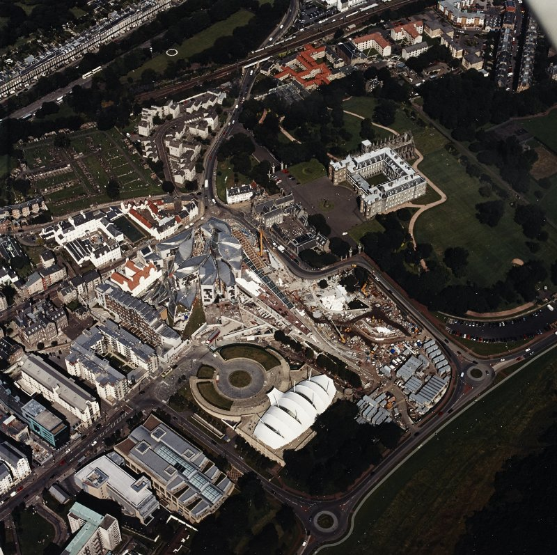 Oblique aerial view centred on the Scottish parliament building with `Our Dynamic Earth¿ and Holyrood palace adjacent, taken from the SSW.