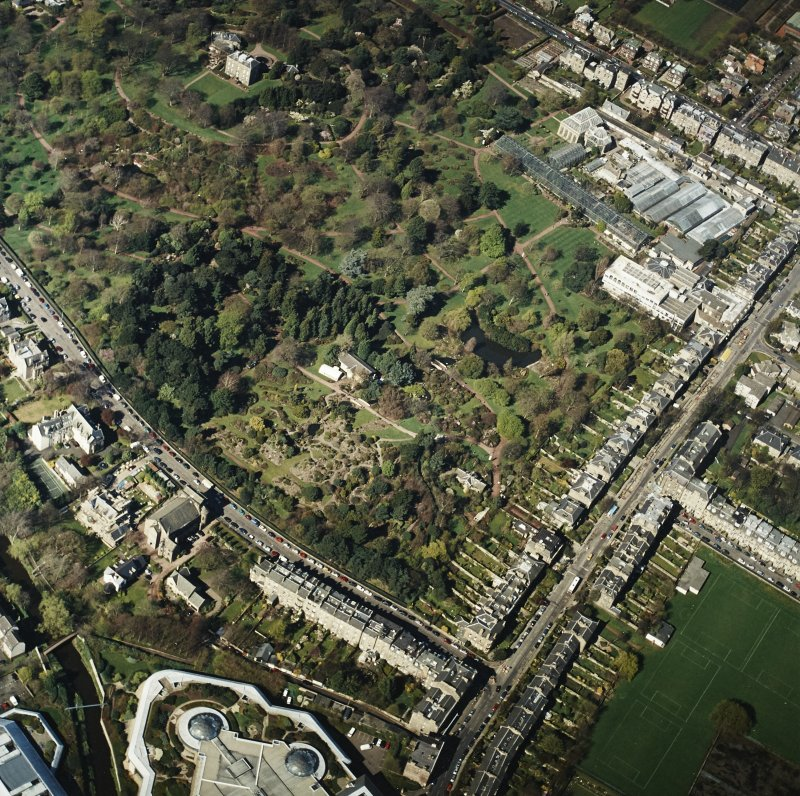 Oblique aerial view of the botanical garden centred on the Herbarium, hall and gate-lodge, taken from the ESE.