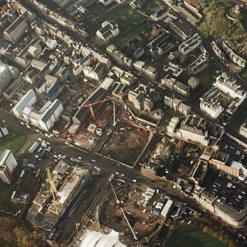 Oblique aerial view of the Edinburgh, Scottish Parliament (under construction) centred on the Parliament building with an exhibition and conference centre adjacent, taken from the SE.