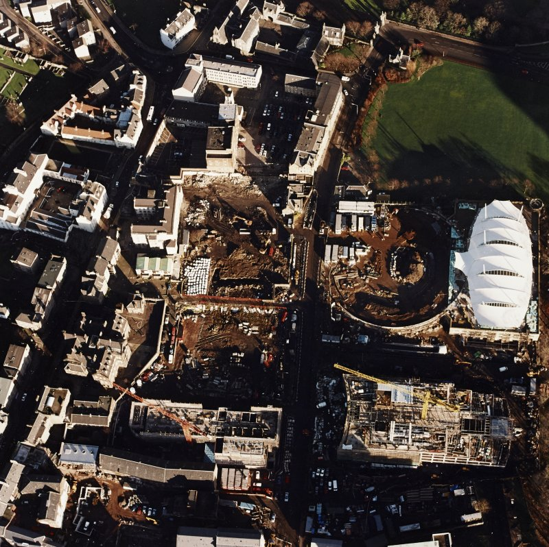 Oblique aerial view of Edinburgh centred on the construction of the Scottish Parliament with the construction of 'Our Dynamic Earth' adjacent, taken from the SW.